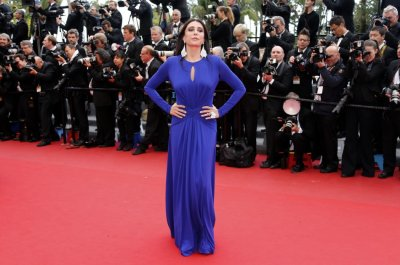 Actress Nadine Labaki poses on the red carpet as she arrives for the screening of the film Inside Llewyn Davis in competition during the 66th Cannes Film Festival in Cannes May 19, 2013.