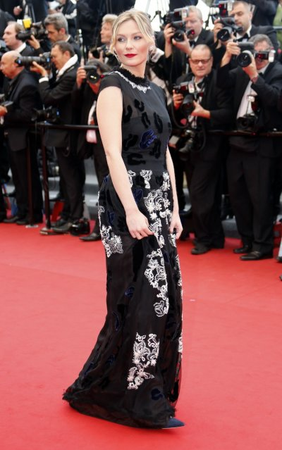 Actress Kirsten Dunst poses on the red carpet as she arrives for the screening of the film Inside Llewyn Davis in competition during the 66th Cannes Film Festival in Cannes May 19, 2013.