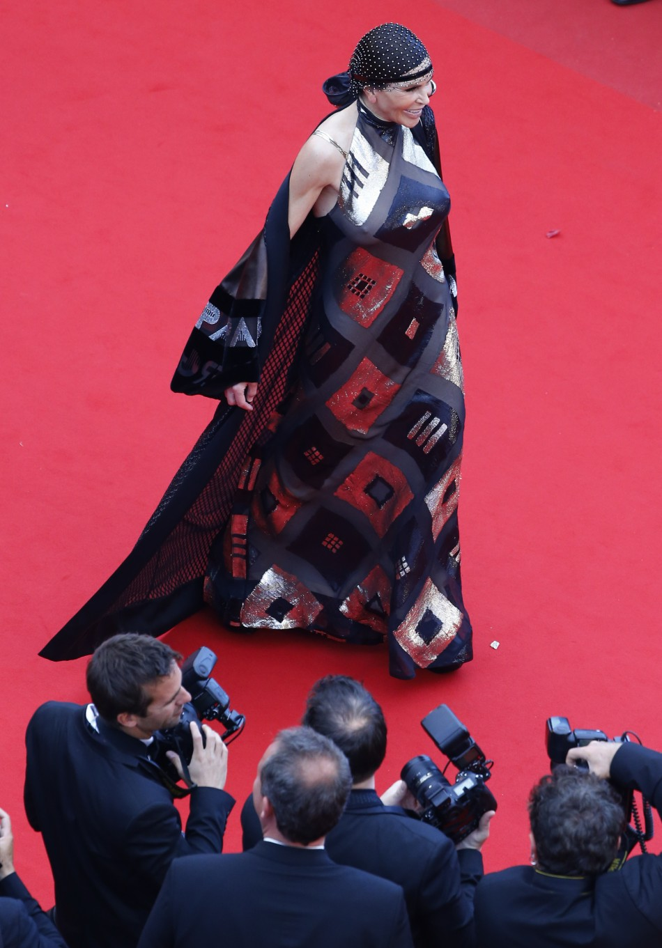 Lebanese businesswoman Mouna Ayoub poses on the red carpet as she arrives for the screening of the film Inside Llewyn Davis in competition during the 66th Cannes Film Festival in Cannes May 19, 2013.