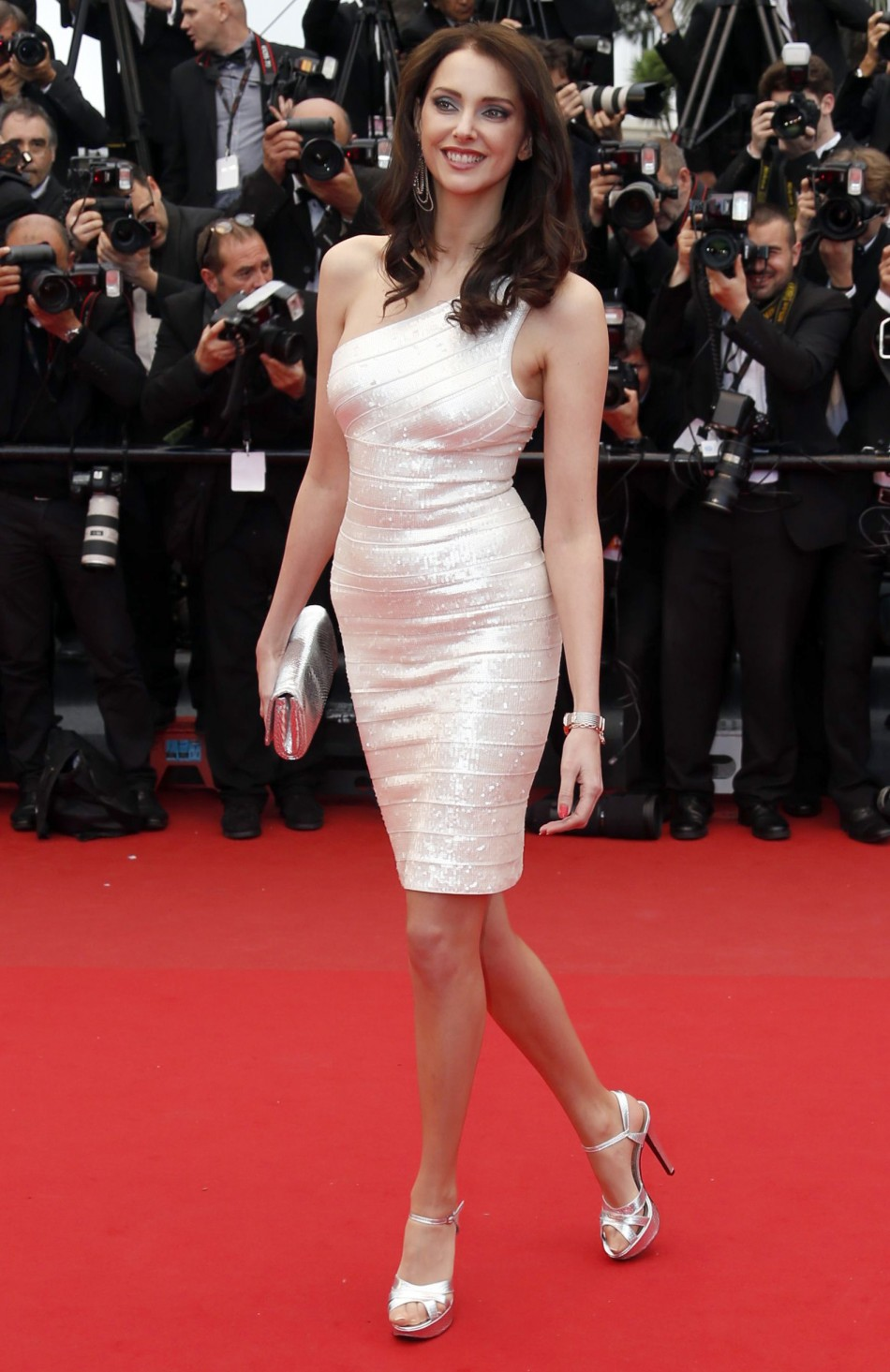 French actress Frederique Bel poses on the red carpet as she arrives for the screening of the film Inside Llewyn Davis in competition during the 66th Cannes Film Festival in Cannes May 19, 2013.