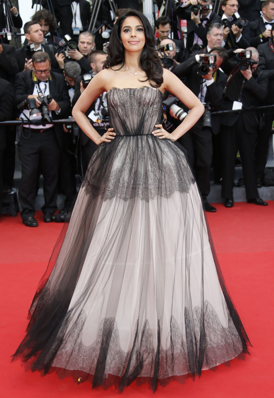 Bollywood actress Mallika Sherawat poses on the red carpet as she arrives for the screening of the film Inside Llewyn Davis in competition during the 66th Cannes Film Festival in Cannes May 19, 2013.
