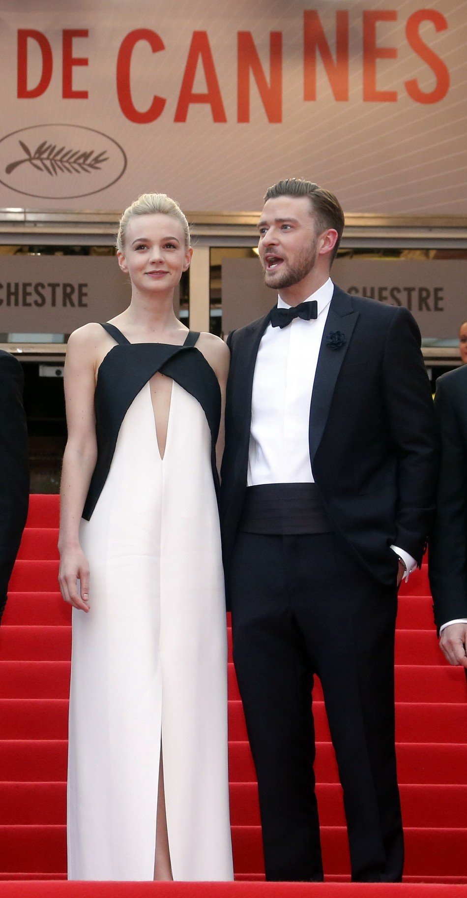 Cast members Carey Mulligan L and Justin Timberlake pose on the red carpet as they arrive for the screening of the film Inside Llewyn Davis in competition during the 66th Cannes Film Festival in Cannes May 19, 2013.