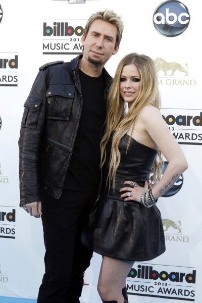 Musicians Chad Krogoer L and Avril Lavigne arrive at the Billboard Music Awards in Las Vegas, Nevada May 19, 2013.