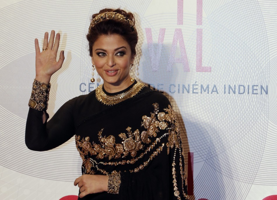 Indian actress Aishwarya Rai poses as she arrives at the evenings gala of the film Bombay Talkies celebrating a hundred years of Indian cinema, during the 66th Cannes Film Festival in Cannes May 19, 2013.