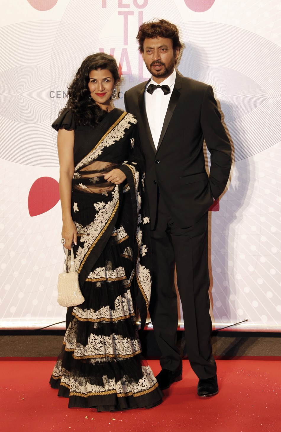 Actress Nimrit Kaur L and actor Irrfan Khan pose as they arrive at the evenings gala of the film Bombay Talkies celebrating a hundred years of Indian cinema, during the 66th Cannes Film Festival in Cannes May 19, 2013