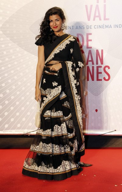Actress Nimrit Kaur poses as she arrives at the evenings gala of the film Bombay Talkies celebrating a hundred years of Indian cinema, during the 66th Cannes Film Festival in Cannes May 19, 2013.