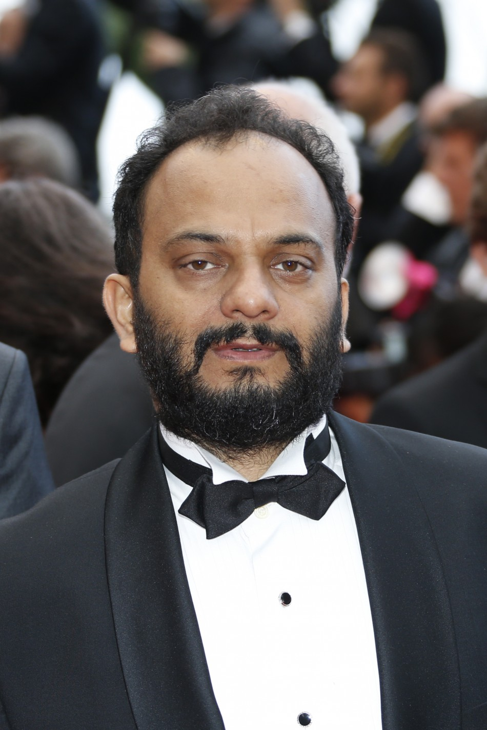 Director Amit Kumar poses on the red carpet as he arrives for the screening of the film Bombay Talkies and the evenings gala celebrating a hundred years of Indian cinema, during the 66th Cannes Film Festival in Cannes May 19, 2013.