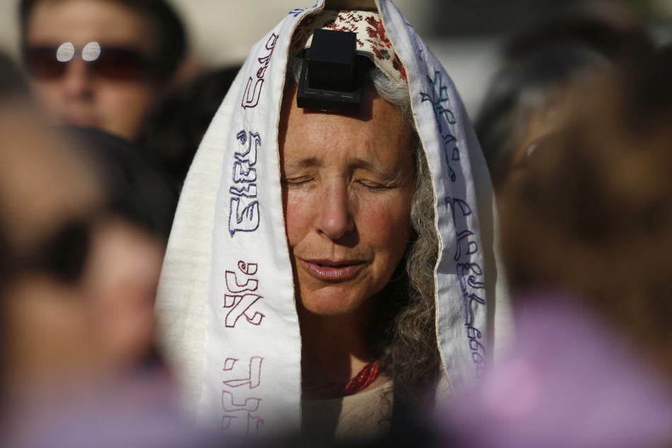 "A member of ""Women of the Wall"" group wears a prayer shawl and Tefillin"