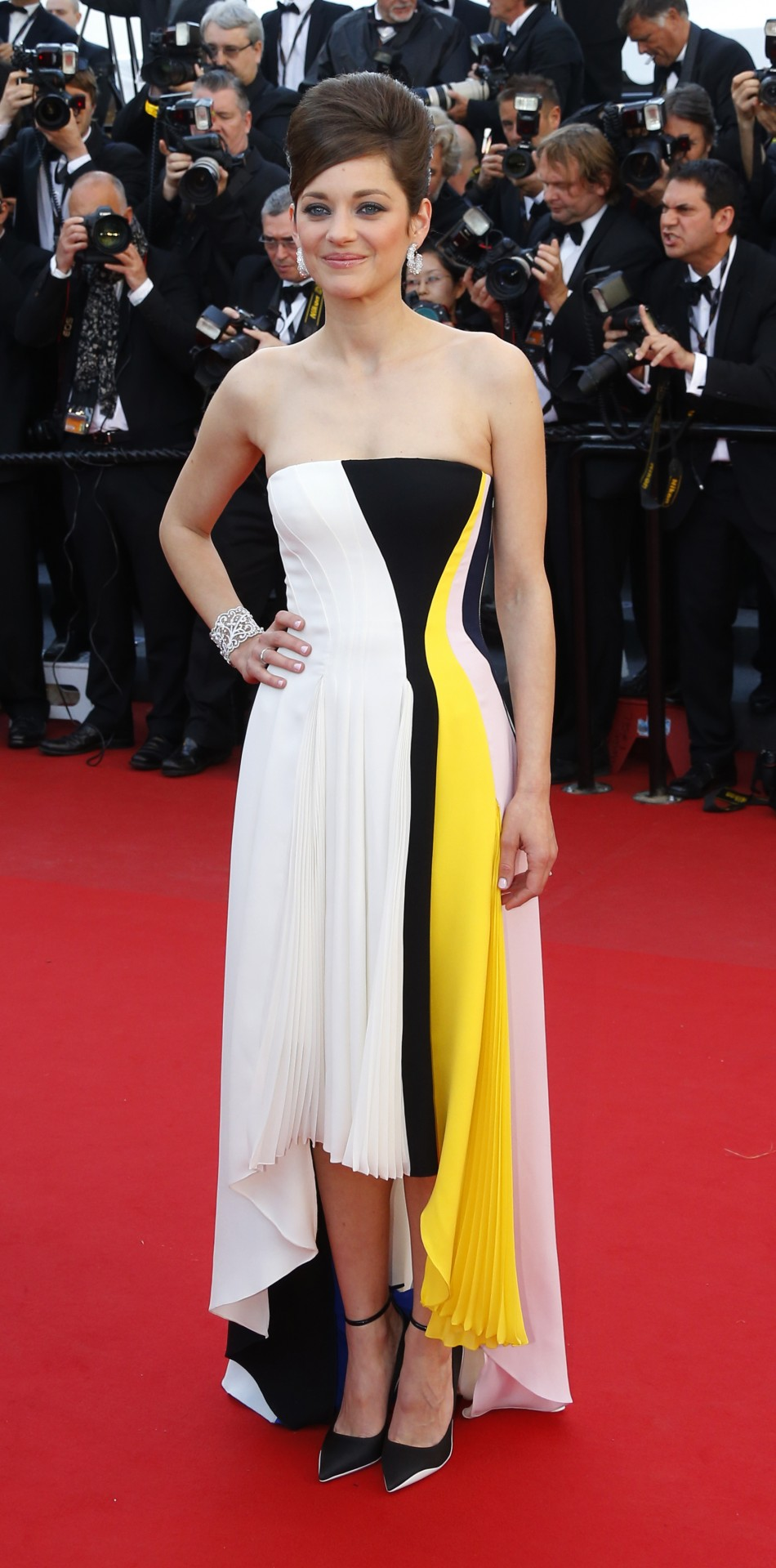 Cast member Marion Cotillard poses on the red carpet as she arrives for the screening of the film Blood Ties during the 66th Cannes Film Festival in Cannes May 20, 2013.