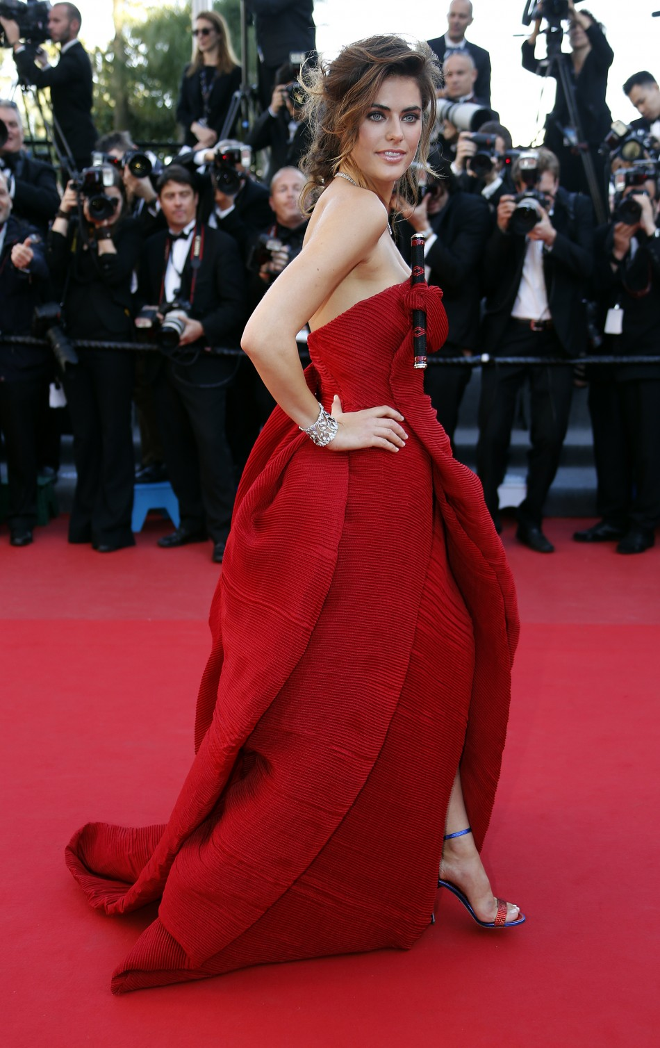 Model Alyson Le Borges poses on the red carpet as she arrives for the screening of the film Blood Ties during the 66th Cannes Film Festival in Cannes May 20, 2013.