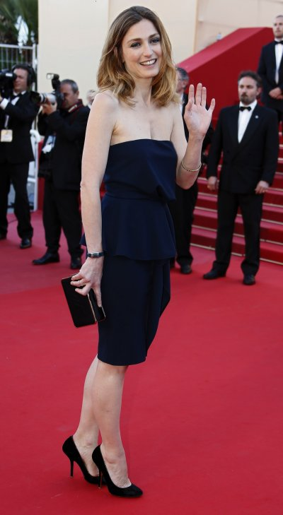 Actress Julie Gayet poses on the red carpet as she arrives for the screening of the film Blood Ties during the 66th Cannes Film Festival in Cannes May 20, 2013.