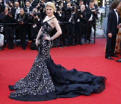 Actress and model Hofit Golan poses on the red carpet as she arrives for the screening of the film Blood Ties during the 66th Cannes Film Festival in Cannes May 20, 2013.