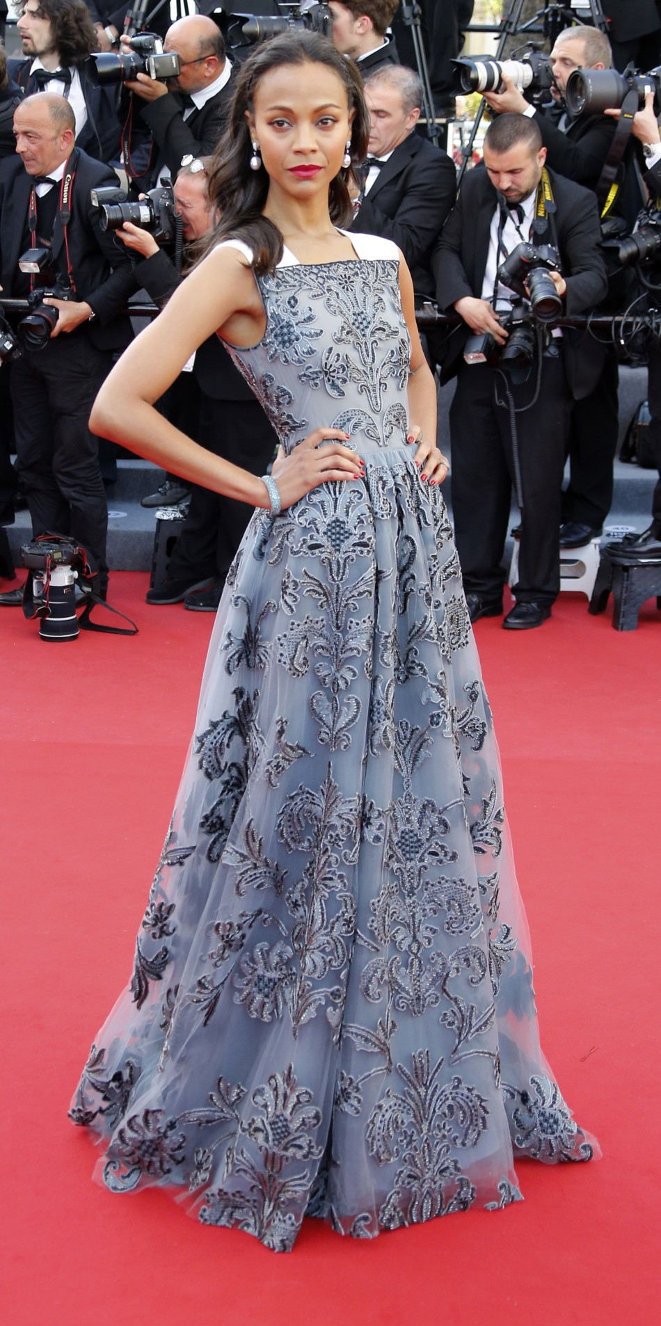 Cast member Zoe Saldana poses on the red carpet as she arrives for the screening of the film Blood Ties during the 66th Cannes Film Festival in Cannes May 20, 2013.