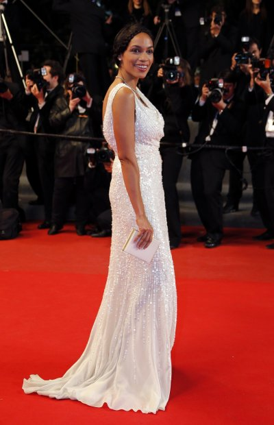 Actress Rosario Dawson poses on the red carpet as she arrives for the screening of the film Wara No Tate Shield of Straw in competition during the 66th Cannes Film Festival in Cannes May 20, 2013.