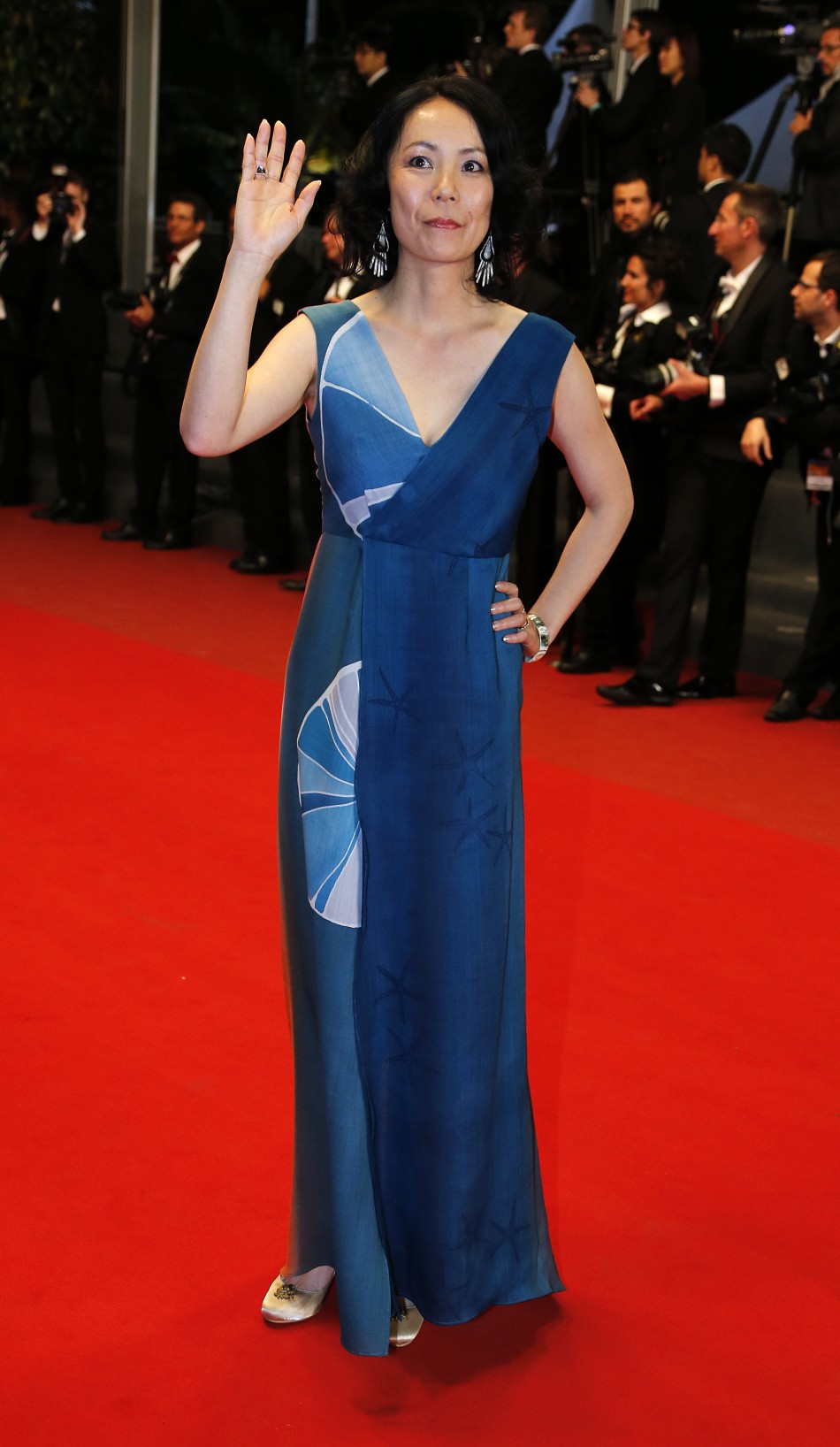 Jury member Naomi Kawase poses on the red carpet as she arrives for the screening of the film Wara No Tate Shield of Straw in competition during the 66th Cannes Film Festival in Cannes May 20, 2013.