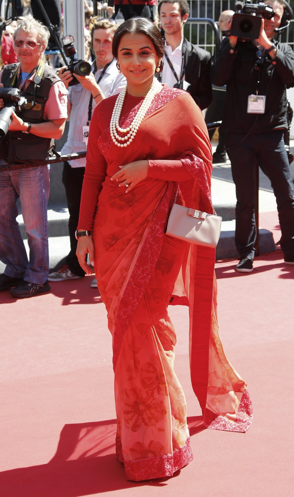 Jury Member actress Vidya Balan poses on the red carpet as she arrives for the screening of the film Un Chateau en Italie in competition during the 66th Cannes Film Festival in Cannes May 20, 2013.