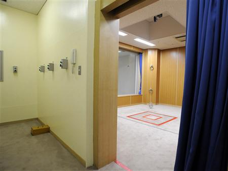 """An execution chamber is seen from the """"button room"""" at the Tokyo Detention Center"""