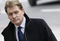 Eric Joyce has been bout a mobile phone at Edinburgh airport (Reuters)