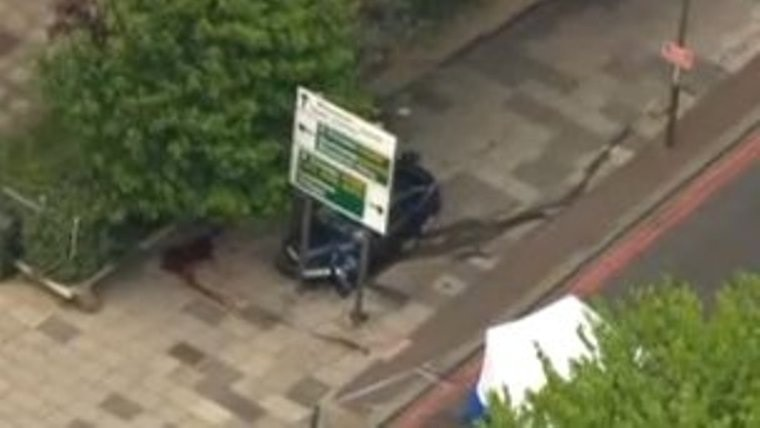 Trails on pavement after Woolwich attack