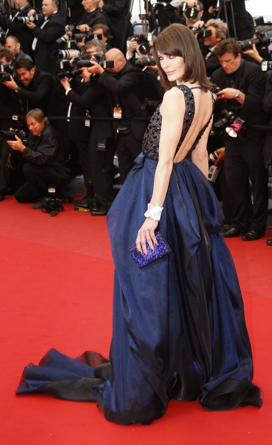 Actress Milla Jovovich poses on the red carpet as she arrives for the screening of the film All is Lost during the 66th Cannes Film Festival in Cannes May 22, 2013.