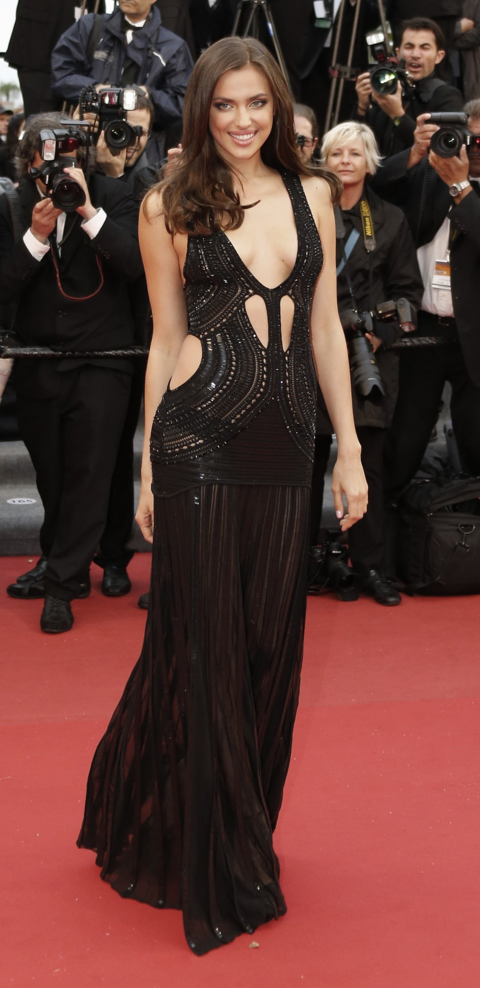 Model Irina Shayk poses on the red carpet as she arrives for the screening of the film All is Lost during the 66th Cannes Film Festival in Cannes May 22, 2013.