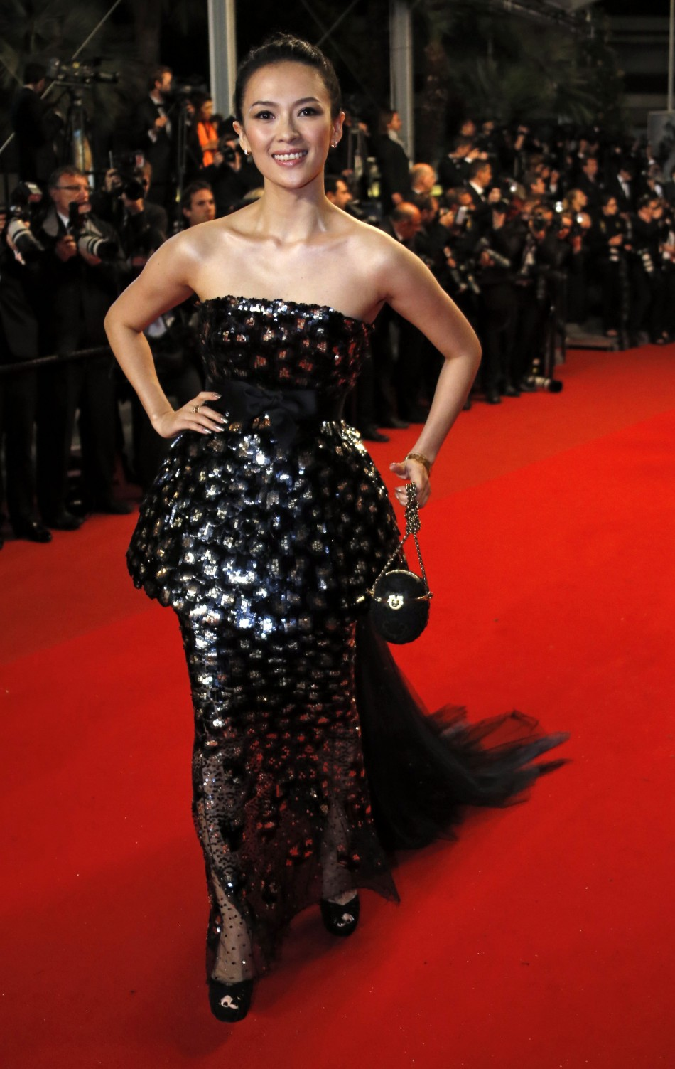 Jury member of Film selection Un Certain Regard actress Zhang Ziyi poses on the red carpet as she arrives for the screening of the film Only God Forgives in competition during the 66th Cannes Film Festival in Cannes May 22, 2013.