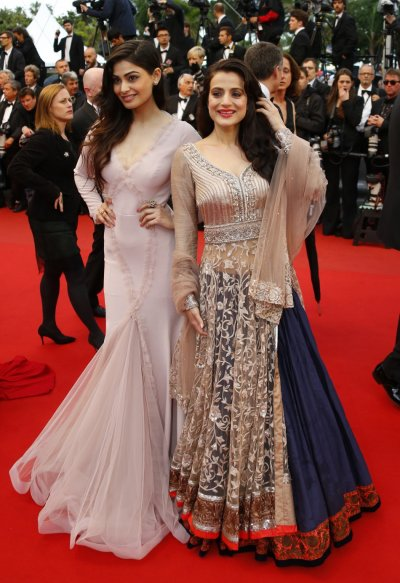 Actresses Ameesha Patel R and Puja Gupta pose on the red carpet as they arrive for the screening of the film All is Lost in competition during the 66th Cannes Film Festival in Cannes May 22, 2013.