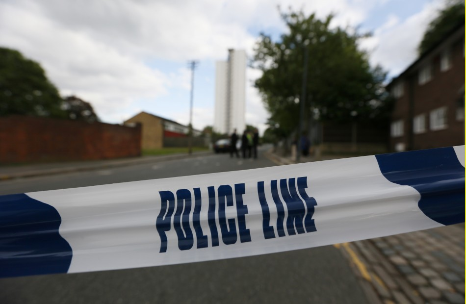 Police tape marks a cordon set up around a crime scene
