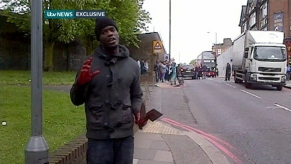 Man in Woolwich holding knives (ITV)