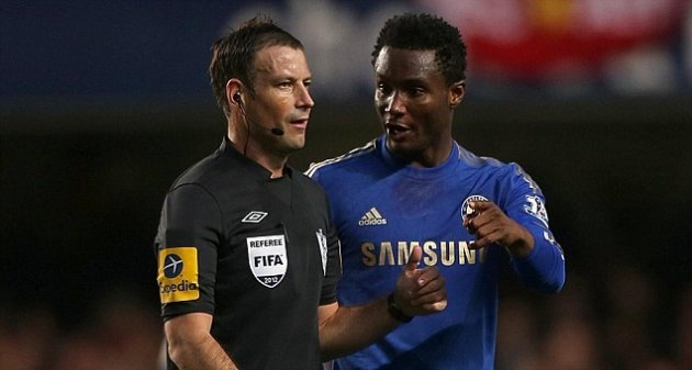 Mark Clattenburg and John Obi Mikel