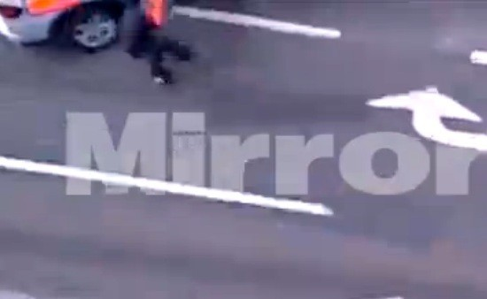 Michael Adebolajo reels away from police car after being hit