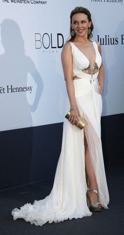 Kylie Minouge wsa the epitome of beauty white in a  Roberto Cavalli number