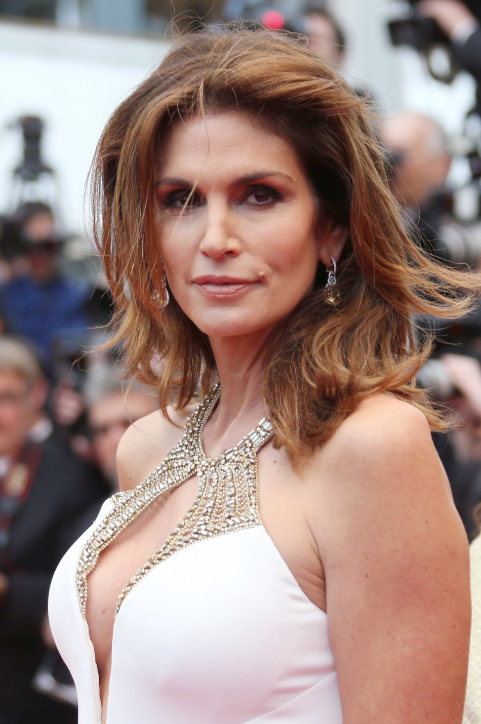Model Cindy Crawford poses on the red carpet as she arrives for the screening of the film 'The Great Gatsby' and for the opening ceremony of the 66th Cannes Film Festival in Cannes