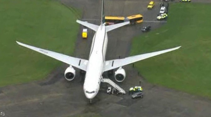 Two men have been charged with endangering an aircraft that was diverted to Stansted on Friday.