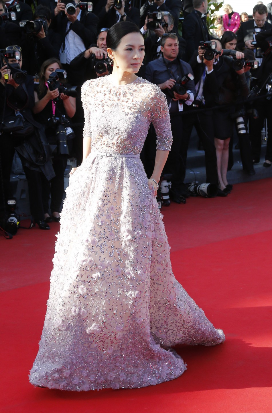 Actress Zhang Ziyi poses on the red carpet as she arrives for the screening of the film La Venus a la Fourrure Venus in Fur in competition during he 66th Cannes Film Festival in Cannes May 25, 2013.
