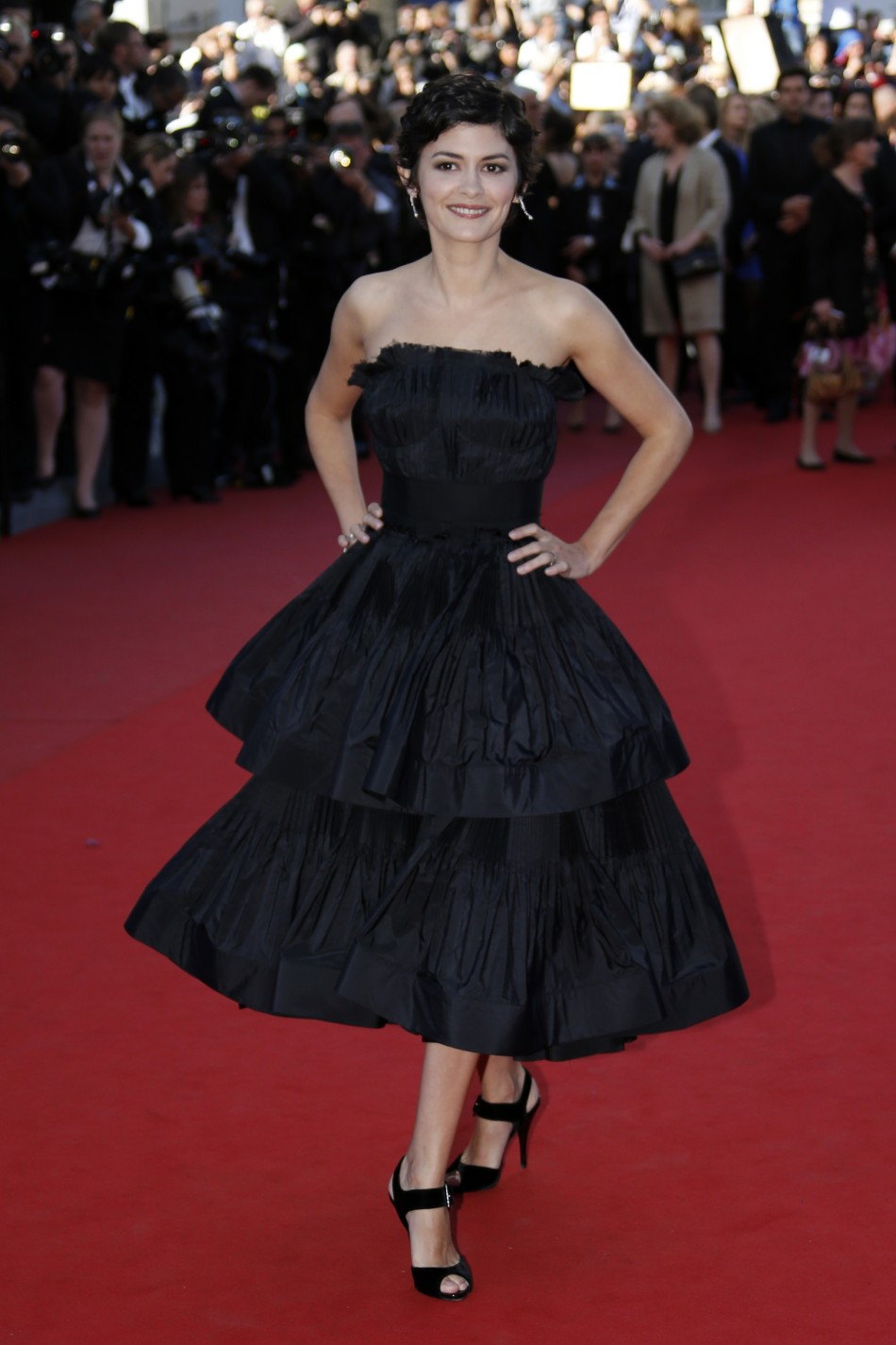 Mistress of Ceremony actress Audrey Tautou poses on the red carpet as she arrives for the screening of the film La Venus a la Fourrure Venus in Fur in competition during the 66th Cannes Film Festival in Cannes May 25, 2013.