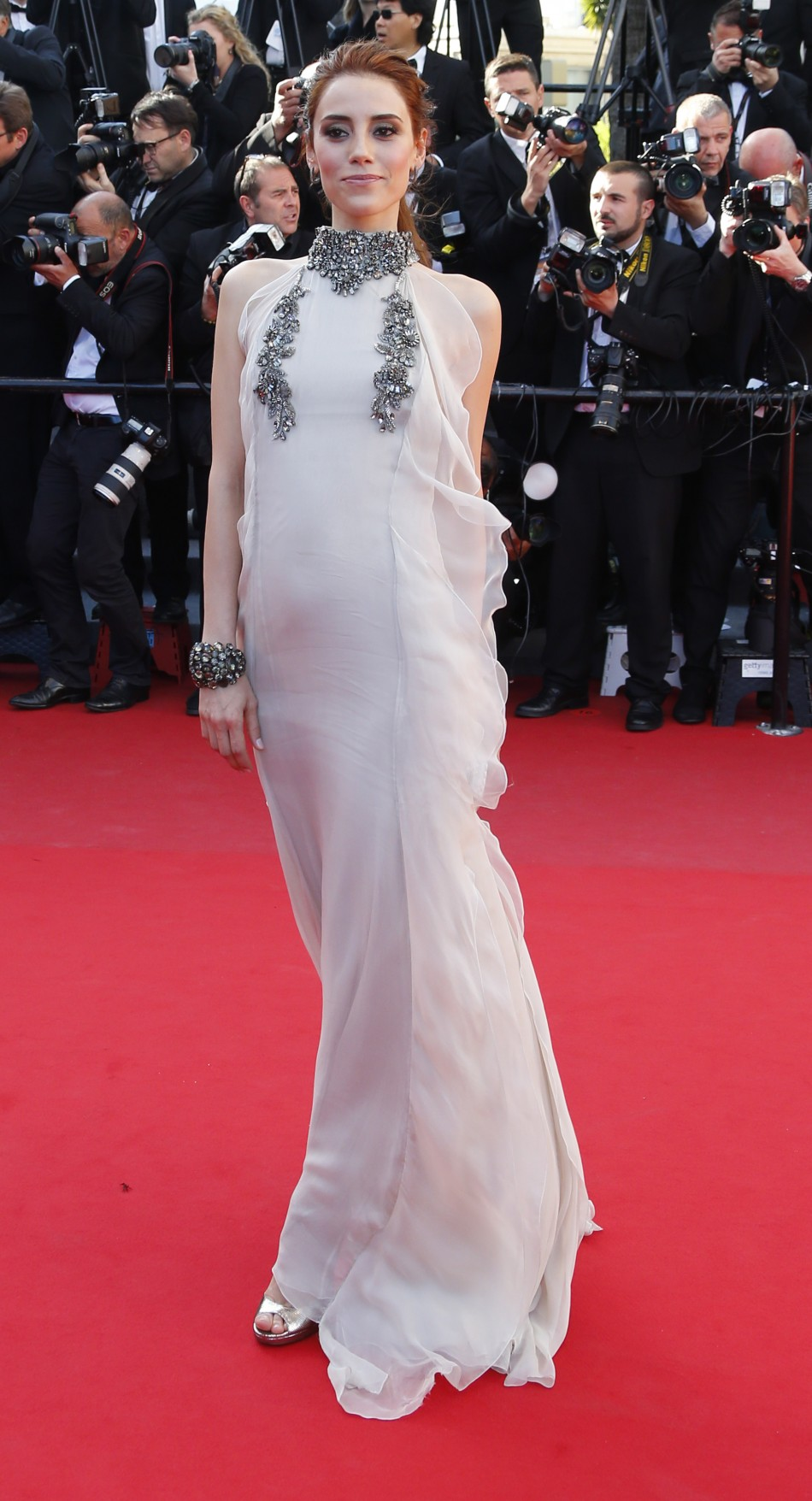 Actress Cansu Dere poses on the red carpet as she arrives for the screening of the film La Venus a la Fourrure Venus in Fur in competition during the 66th Cannes Film Festival in Cannes May 25, 2013.