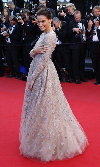 Actress Saadet Aksoy poses on the red carpet as she arrives for the screening of the film La Venus a la Fourrure Venus in Fur in competition during the 66th Cannes Film Festival in Cannes May 25, 2013.