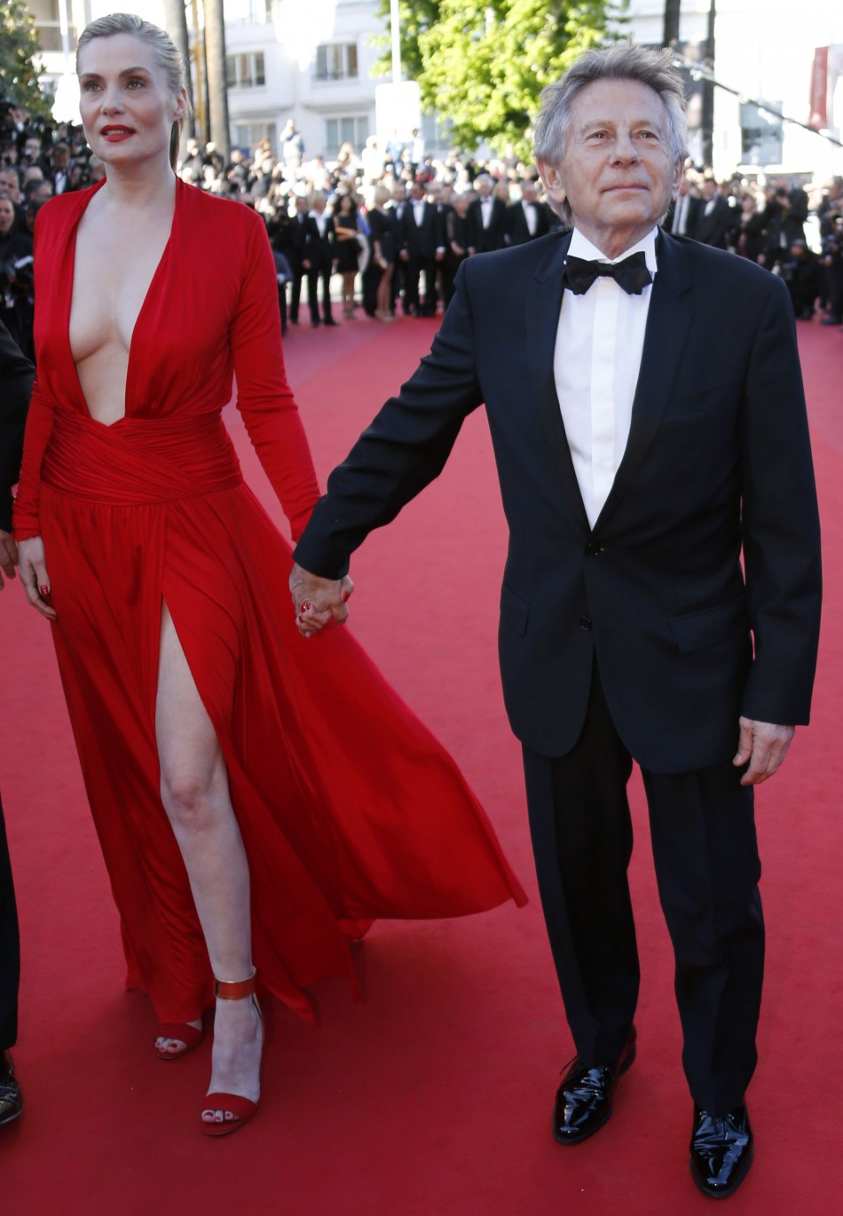 Director Roman Polanski R poses with his wife and cast member Emmanuelle Seigner R on the red carpet as they arrive for the screening of the film La Venus a la Fourrure Venus in Fur in competition during the 66th Cannes Film Festival in