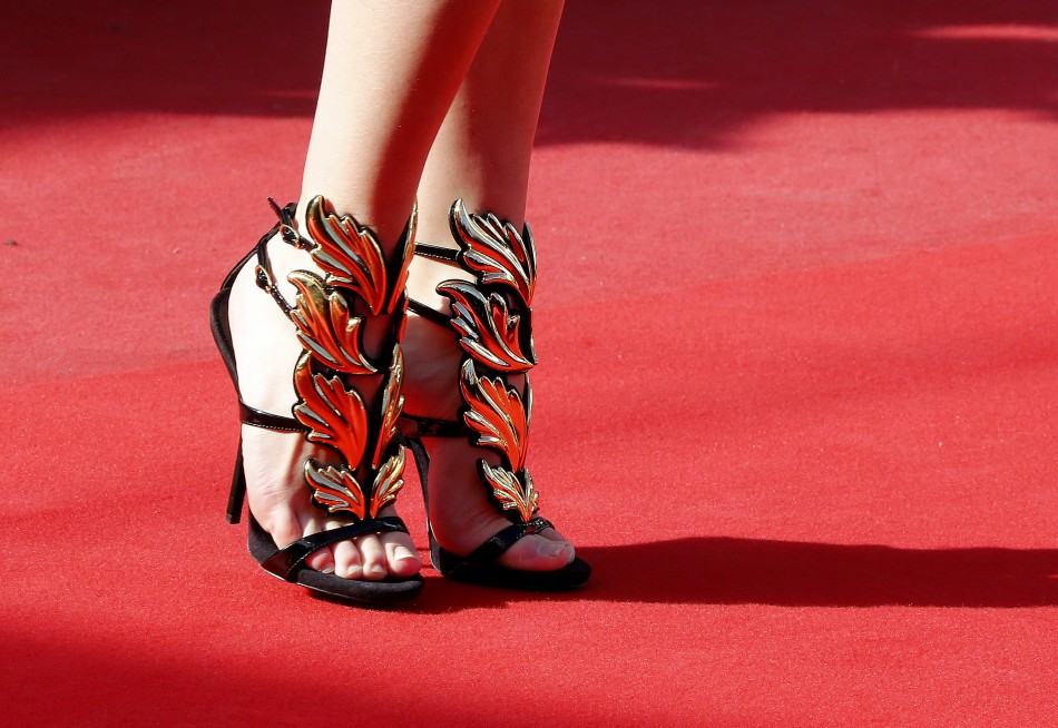 The shoes of a guest are pictured as she poses on the red carpet arriving for the screening of the film La Venus a la Fourrure Venus in Fur in competition during the 66th Cannes Film Festival in Cannes May 25, 2013.