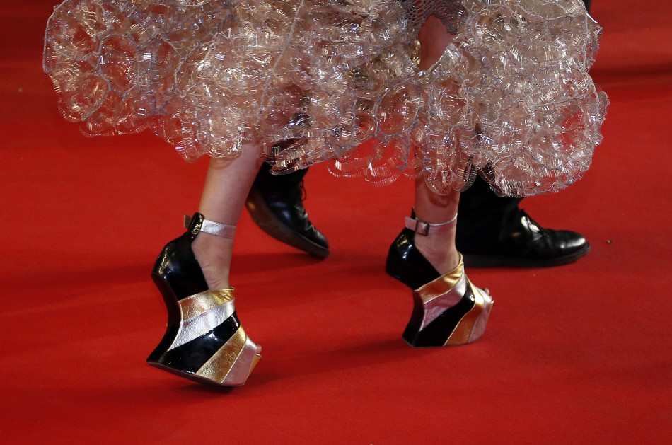 The shoes of a guest are pictured as she walks on the red carpet arriving for the screening of the film La Vie DAdele in competition during the 66th Cannes Film Festival in Cannes May 23, 2013.