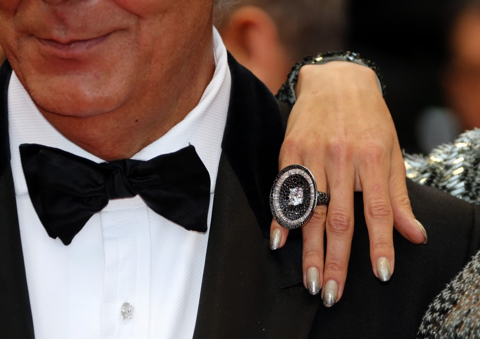 Fawaz Gruosi L, founder of jewellery company de Grisogono, and model Alessandra Ambrosio pose on the red carpet as they arrive for the screening of the film All is Lost during the 66th Cannes Film Festival in Cannes May 22, 2013.