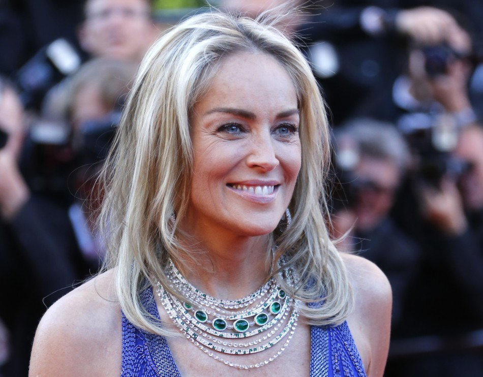 Actress Sharon Stone poses on the red carpet as she arrives for the screening of the film Behind the Candelabra in competition during the 66th Cannes Film Festival in Cannes May 21, 2013.