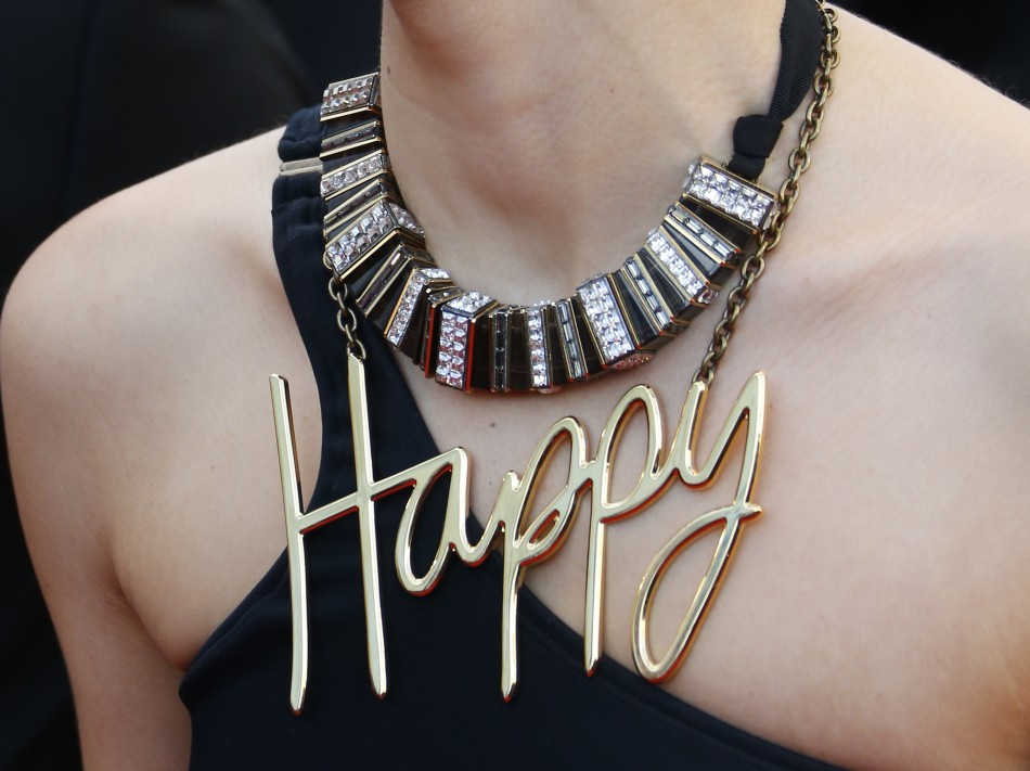 The necklace of a guest is picured as she poses on the red carpet arriving for the screening of the film Blood Ties during the 66th Cannes Film Festival in Cannes May 20, 2013.