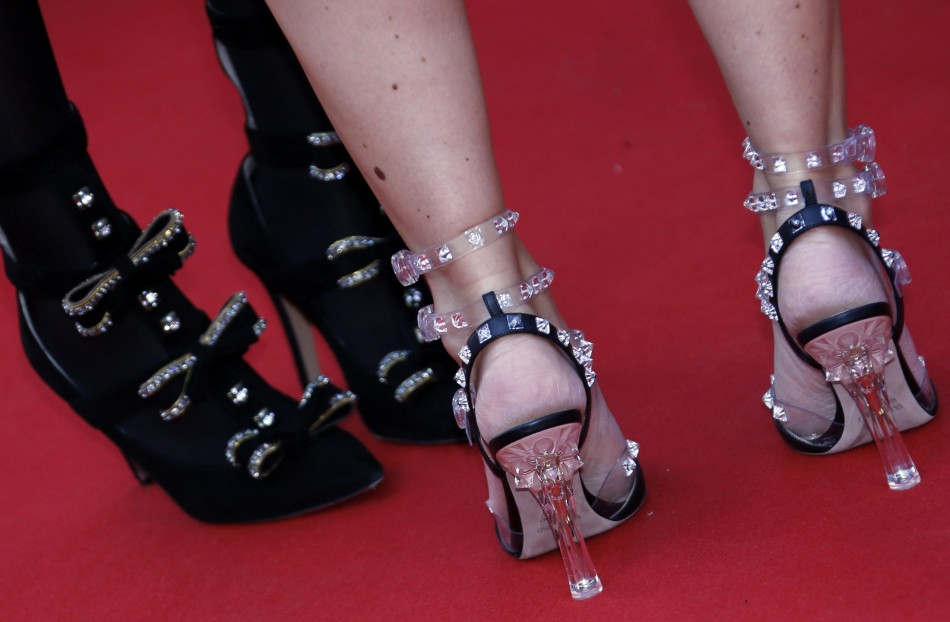 The shoes of guests are pictured on the red carpet as they arrive for the screening of the film Le Passe The Past in competition during the 66th Cannes Film Festival in Cannes May 17, 2013.