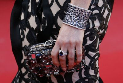The handbag of actress and model Hofit Golan is pictured as she arrives for the screening of the film Blood Ties during the 66th Cannes Film Festival in Cannes May 20, 2013.
