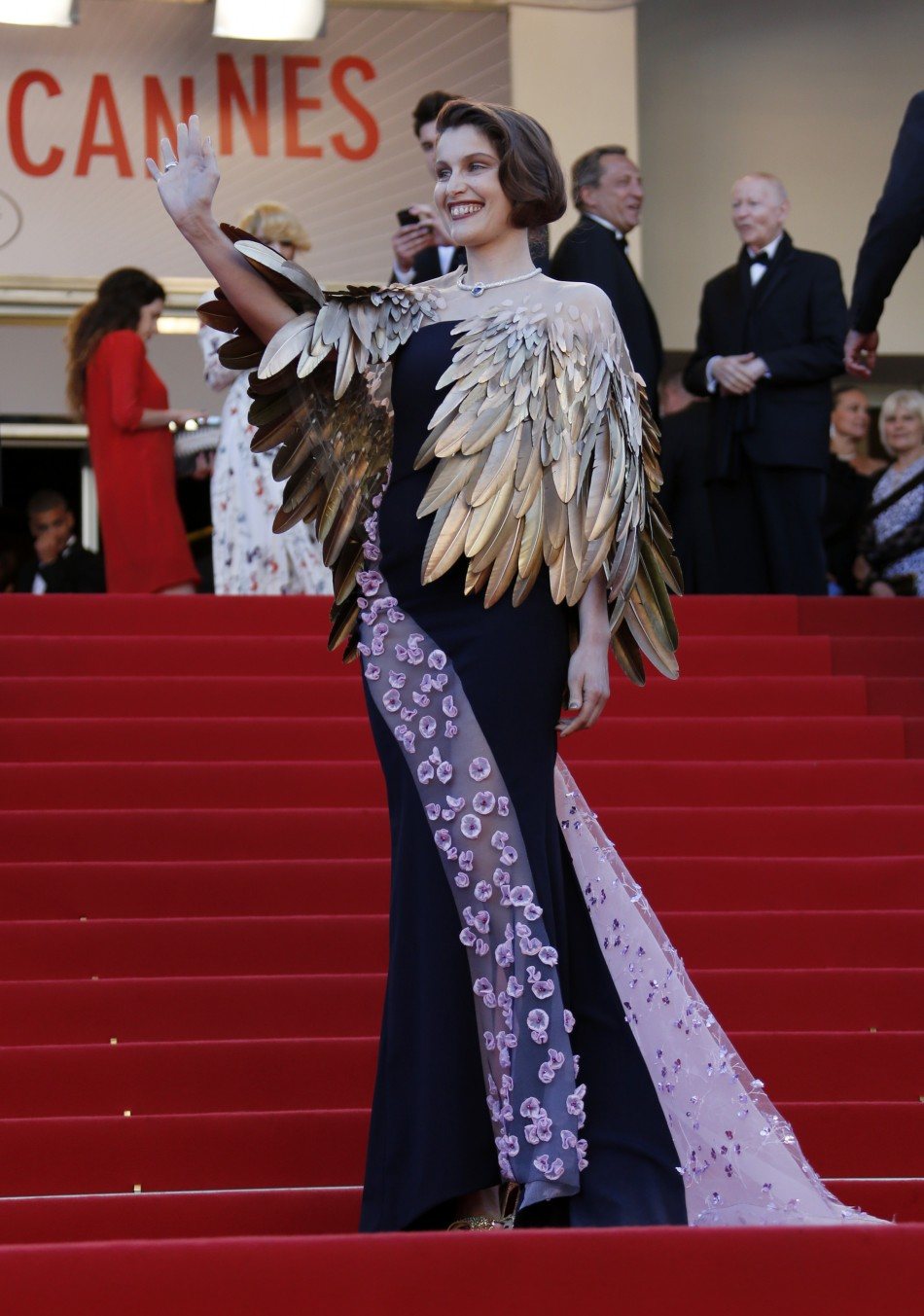 Actress Laetitia Casta poses on the red carpet as she arrives at the closing ceremony of the 66th Cannes Film Festival in Cannes May 26, 2013.