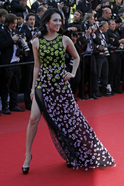 Jury member of Film selection Un Certain Regard actress Zhang Ziyi poses on the red carpet as she arrives at the closing ceremony of the 66th Cannes Film Festival in Cannes May 26, 2013.