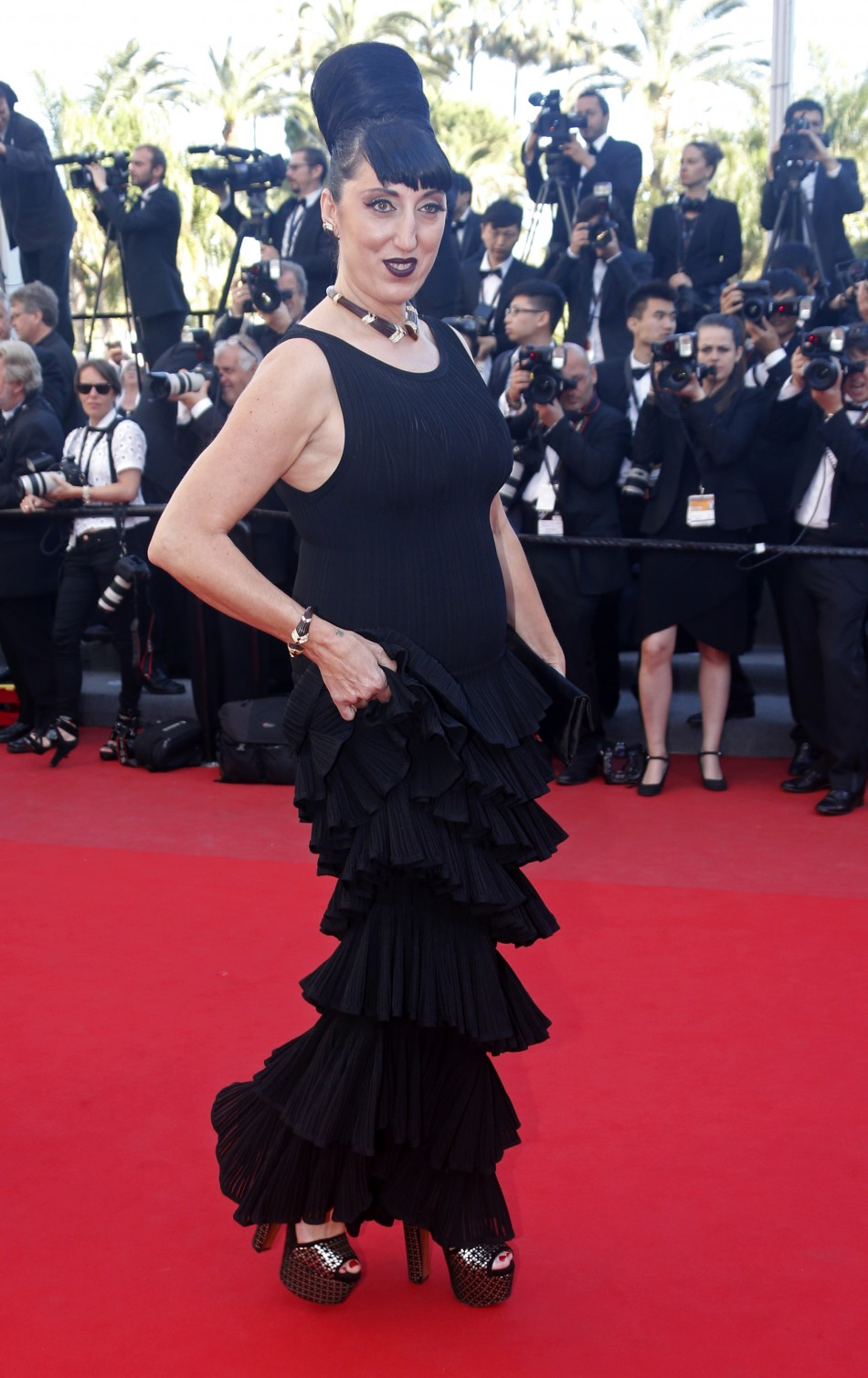 Actress Rossy de Palma poses on the red carpet as she arrives at the closing ceremony of the 66th Cannes Film Festival in Cannes May 26, 2013.