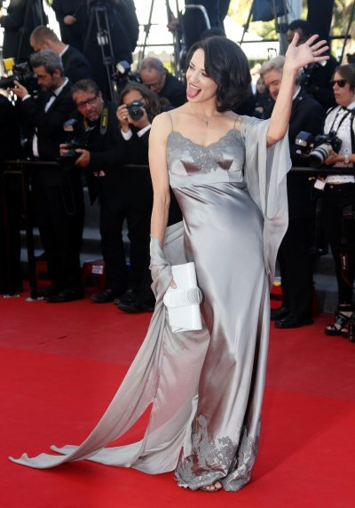 Actress Asia Argento poses on the red carpet as she arrives at the closing ceremony of the 66th Cannes Film Festival in Cannes May 26, 2013.